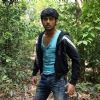 Nitin Reddy standing in a jungle | Agyaat Photo Gallery