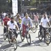 Salman Khan at the cycling event at the Carter Road - Car Free Day in Mumbai on Feb. 24, 2013. (Photo: Sandeep Mahankal/IANS)