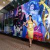 Shreya Saran poses alongside a customized SIIMA bus at the Press Meet at Malaysia