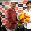 Dhanush felicitated at the Filmfare Readers Meet at the Reliance Digital Store