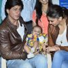 Shahrukh Khan with a baby fan at the Happy New Year Event