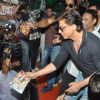 Shahrukh Khan distributes the Happy New Year DVDs among his Fans at the theatre