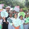 Ajaz Khan poses with children at 'Van Mahotsav Week'
