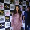 Neha Dhupia in an asymmetrical dress