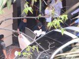 Karan Johar taking his babies home from hospital
