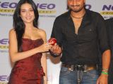 Amrita Rao & Harbhajan Singh pose for pictures at a press conference by Neo Cricket channel