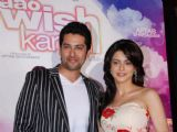 Aftab Shivdasani and Aamna Sharif pose for the photographers during the music release of forthcoming film ''Aao Wish Karein'' in Mumbai