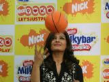 Raveena Tandon poses for the photographers during the announcement of Nickelodeon''s pioneering worldwide movement ''Let''s Just Play'' India''s first Play-a-thon in Mumbai