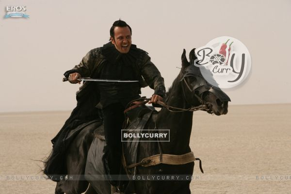 Kay Kay Menon sitting on a horse