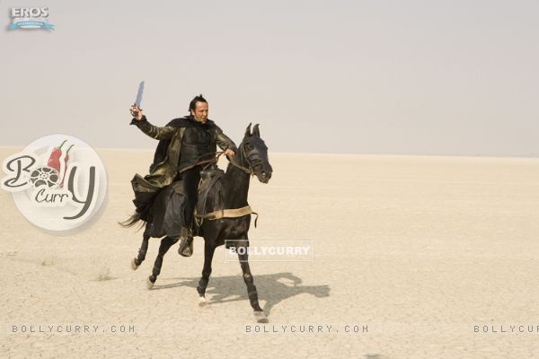 Kay Kay Menon sitting on a horse for fighting