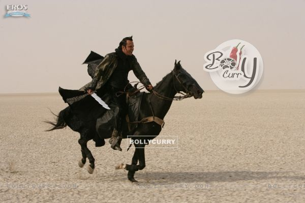 Kay Kay Menon sitting on a black horse