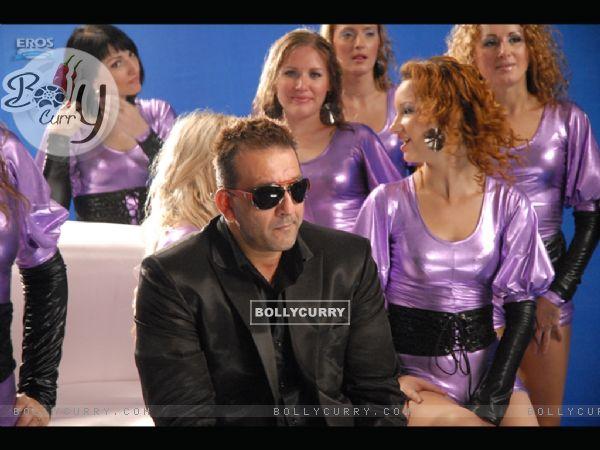 Sanjay Dutt sitting with beautiful ladies
