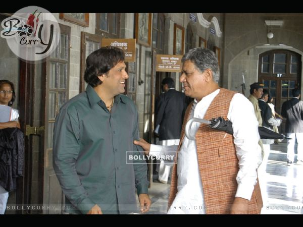 Om Puri talking to Govinda