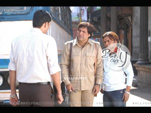 Rajpal Yadav and Govinda talking to someone