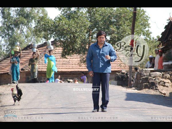 Govinda walking on a road