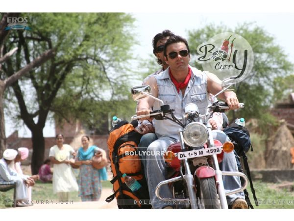 Sohail and Vatsal sitting on a bike
