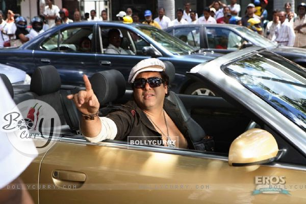 Govinda sitting on a car