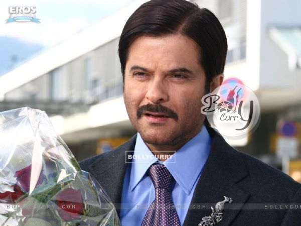 Handsome Anil Kapoor with red roses
