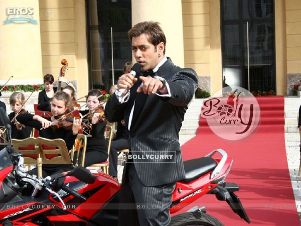 Salman standing close to red bike