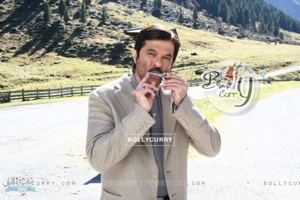 Anil Kapoor playing a harmonica (12353)