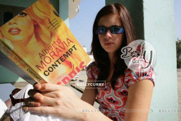 Kalki Koechlin with a book