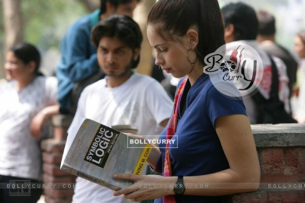 Kalki Koechlin reading a book