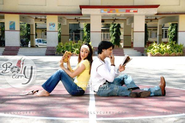 Prashant Chainani and Nauheed Cyrusi reading book