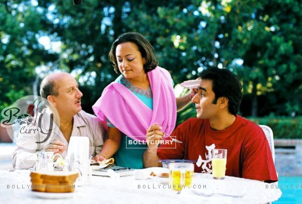 Ranjita Chakravarty serves food to Anupam and Anubhav