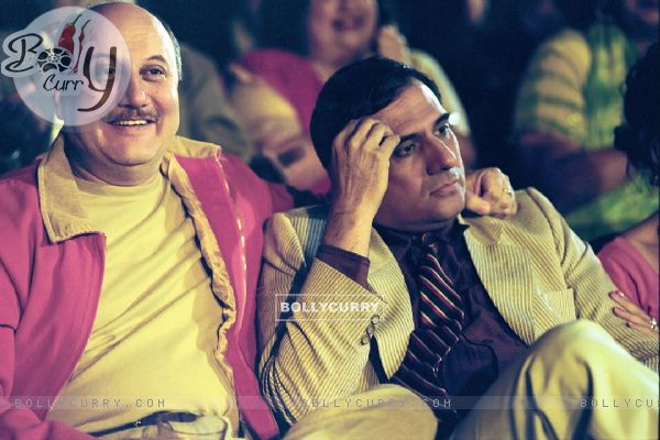 Anupam looking happy and Boman looking confused