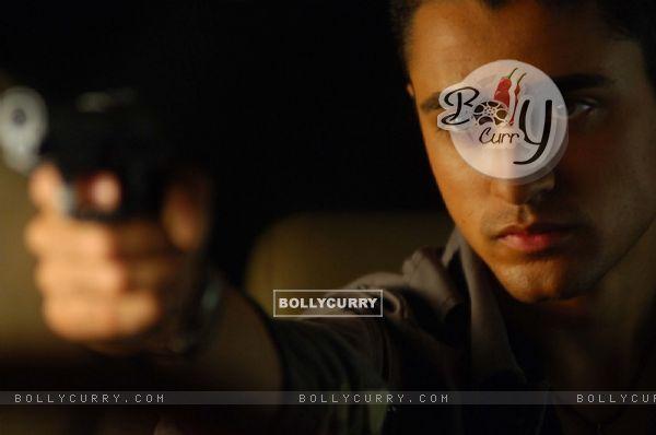 Imraan Khan with a rifle
