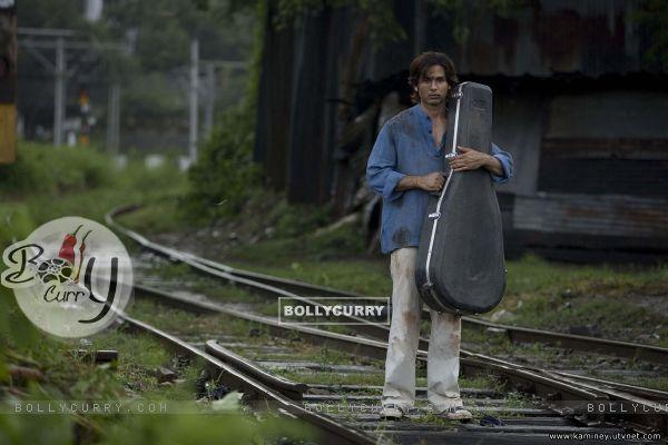 Shahid Kapoor standing on a railway track