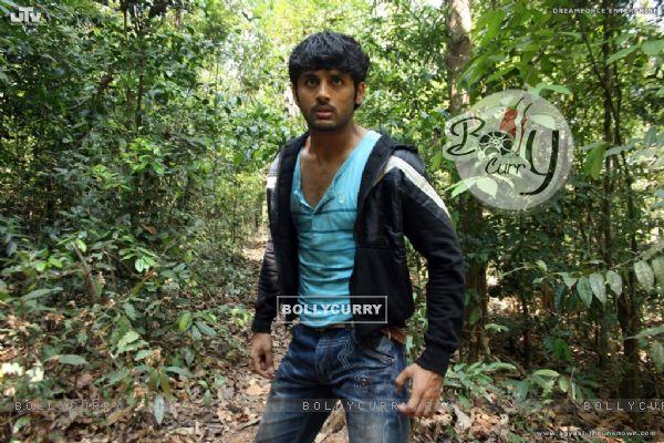 Nitin Reddy standing in a jungle (20400)