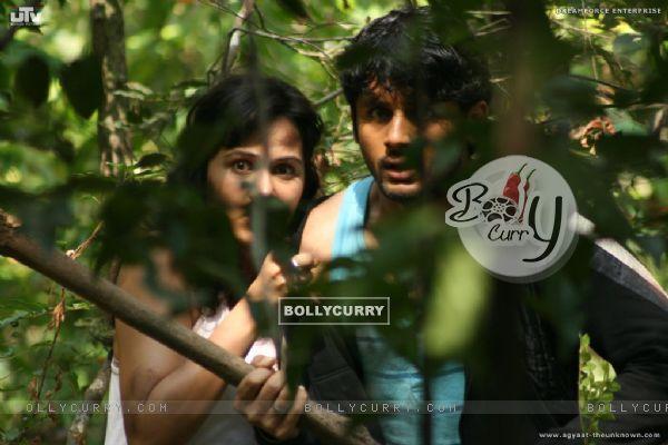 Nitin Reddy and Nisha Kothari looking feared