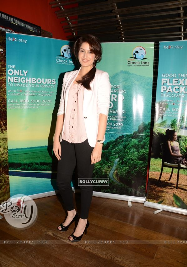 Actress Sagarika Ghatge poses for the photographers during the Share Your Travel Experience Contest in Mumbai. .