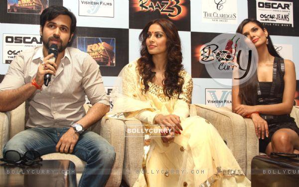 Bollywood actors Emraan Hashmi, Bipasha Basu and Esha Gupta at a press meet for the film Raaz-3 in New Delhi .