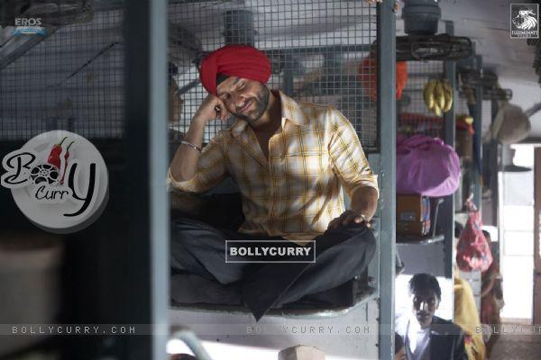 Saif Ali Khan sitting on a train