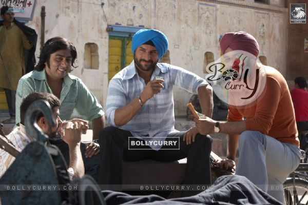 Saif Ali Khan sitting with his friend