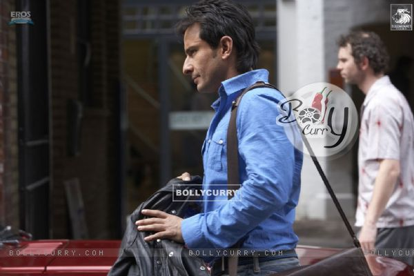Saif Ali Khan wearing a blue shirt