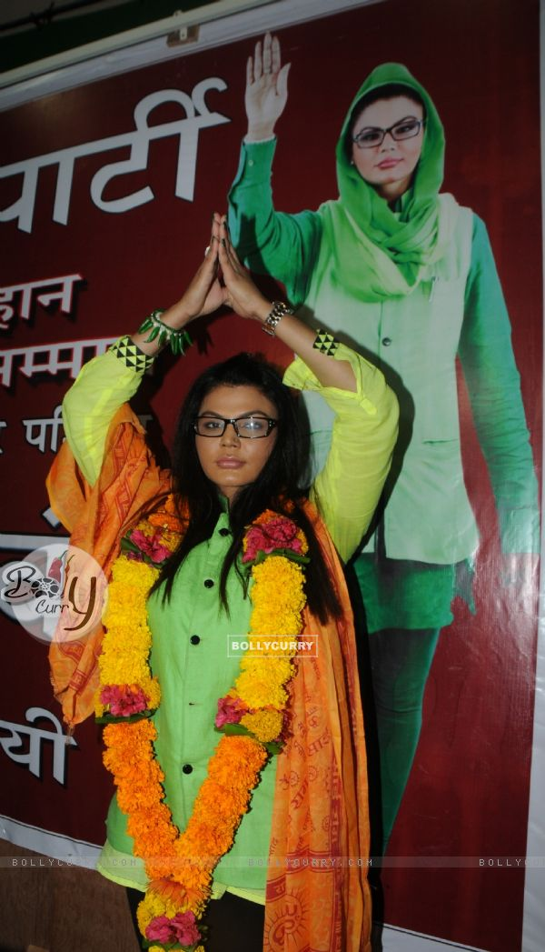 Rakhi Sawant with her political party banner of 'Rashtriya Aam Party'