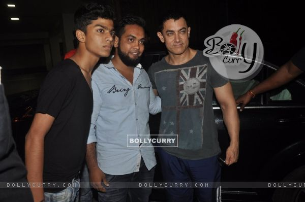 Aamir Khan poses with fans