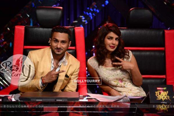 Yo Yo Honey Singh poses with Priyanka Chopra for the camera