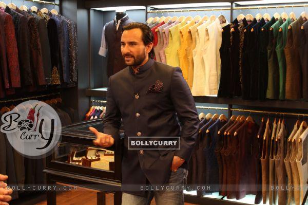 Saif Ali Khan poses for the media at Raghavendra Rathore's Men's Jewellery at his New Bandra Store