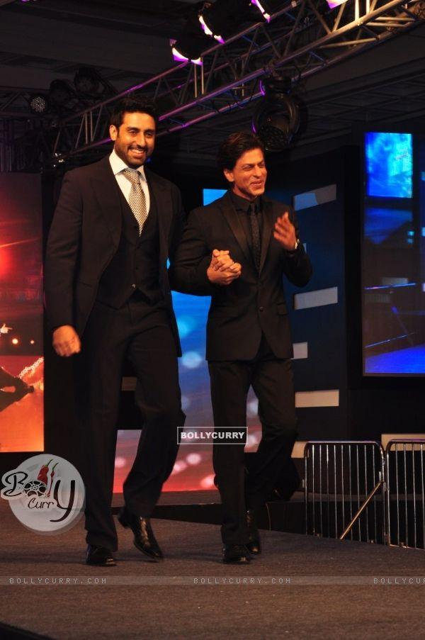 Shah Rukh Khan and Abhishek Bachchan walk the ramp at the Palam Silks, Happy New Year Event