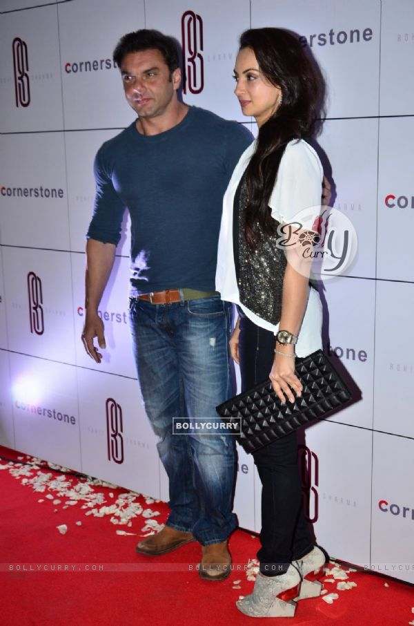 Sohail Khan poses with wife Seema Khan at Rohit Sharma's Bash