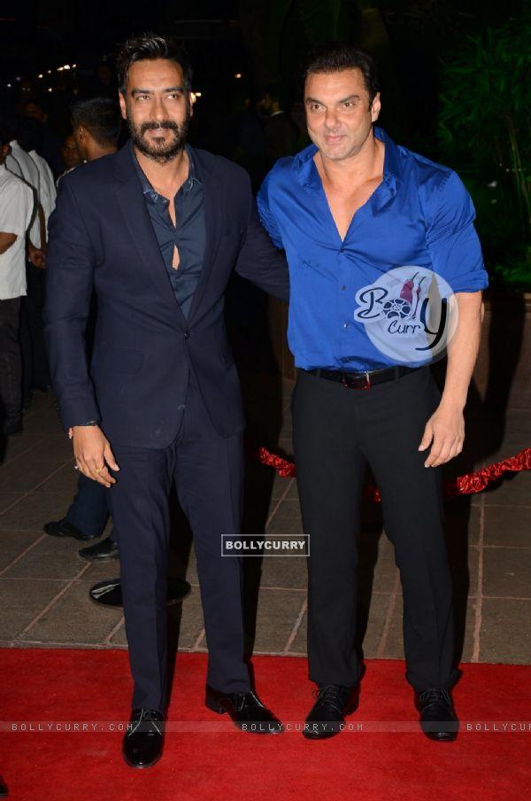 Ajay Devgn and Sohail Khan pose for the media at Arpita Khan's Wedding Reception