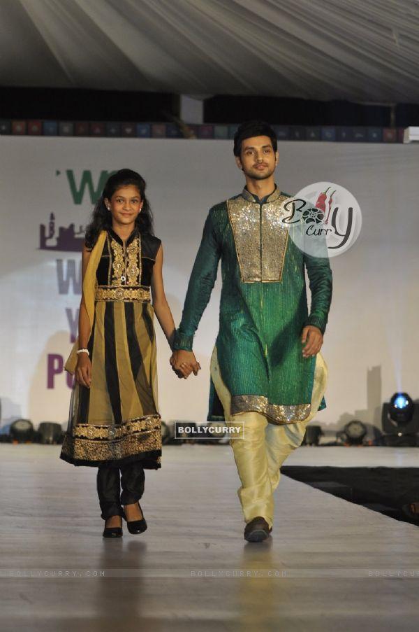Shakti Arora walks the ramp with a small girl at Wellingkar's 26/11 Tribute