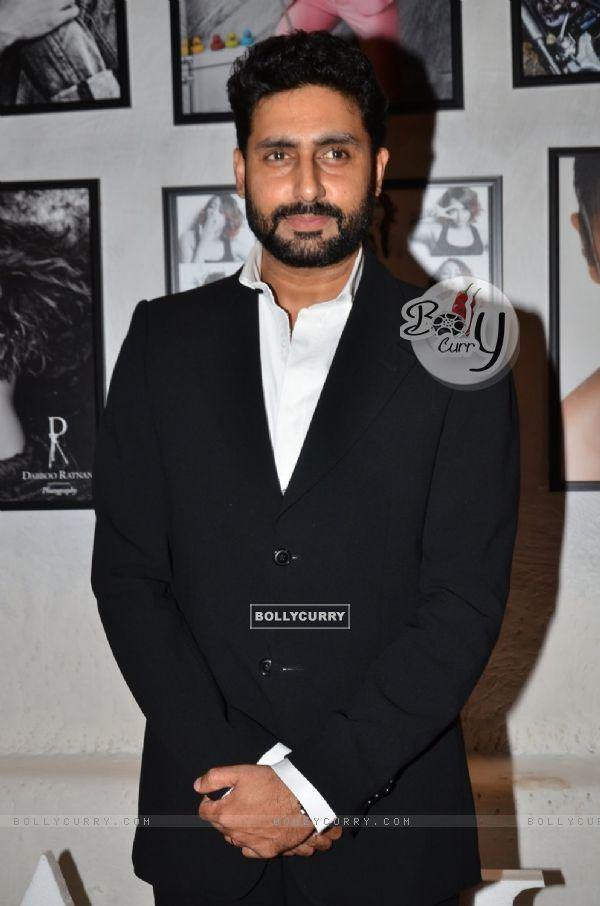 Abhishek Bachchan poses for the media at Dabboo Ratnani's Calendar Launch