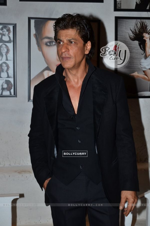 Shah Rukh Khan poses for the media at Dabboo Ratnani's Calendar Launch