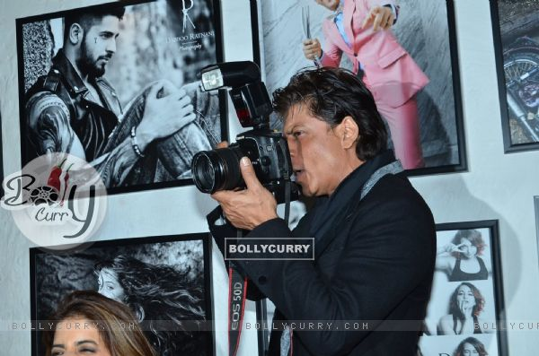 Shah Rukh Khan was snapped clicking photos at Dabboo Ratnani's Calendar Launch