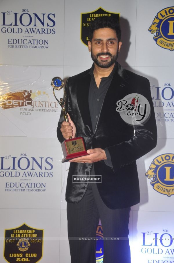 Abhishek Bachchan poses with her award at Lion Gold Awards